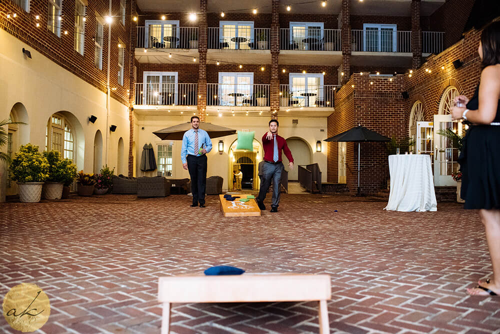 guests playing cornhole at The Alexandrian hotel wedding