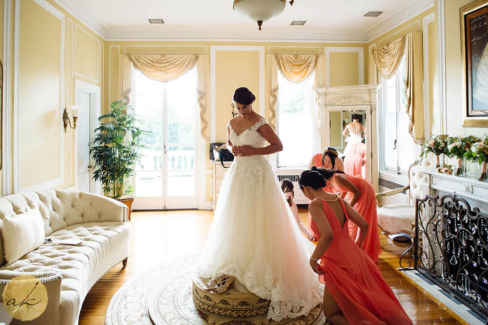 bride getting dressed at Oxon Hill Manor wedding 41